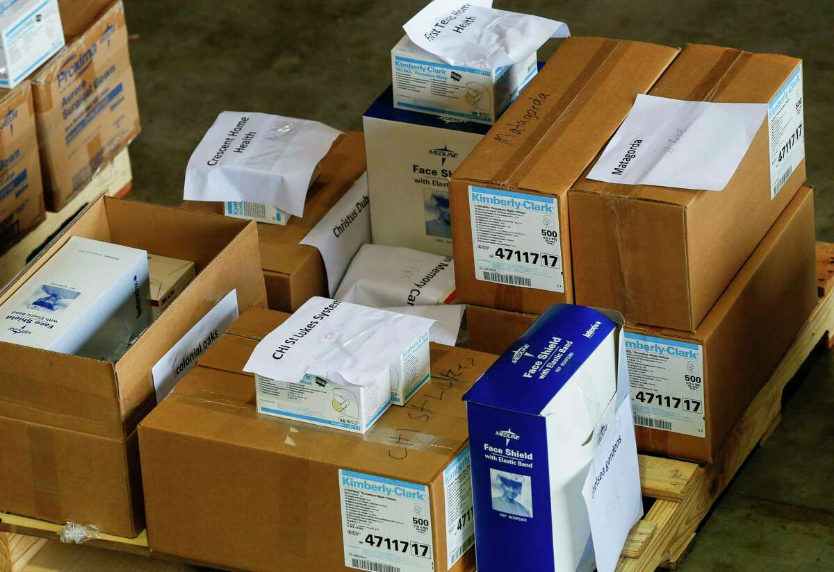 Medical supplies like N95 face masks, face shields, surgical masks, protective gowns, and gloves are being distributed to hospitals, first responders, and health care facilities in the Texas southeast region by the South East Texas Regional Advisory Council on Wednesday, March 18, 2020, in Houston.