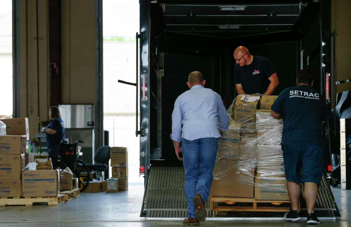SETRAC Emergency Operations staff loads a pallet with medical supplies into a trailer for Montgomery County testing sites at the Strategic National Stockpile distribution site Wednesday, March 18, 2020, in Houston.