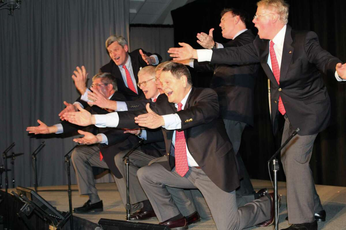 The men are dressed in suit and tie for the finale of a previous Gridiron Club of New Canaan show at the Italian American Club in Stamford. The actors left to right are Steve Pond, Bill Walbert, Eric Thunem, Bruce Wilkinson, John Walsh, Tom Butterworth, and Robert Curry. After discussion of all considerations, the club's Board of Directors has decided to postpone its 2020 show. It will now take place October 30, 2020.