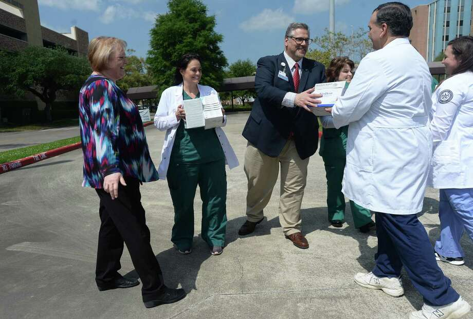 LSCPA's Shirley MacNeill (far left) and Brandon Buckner (right) met with representatives from Christus Health of Southeast Michigan, including RN Katie Singleton and Paul Guidroz, for a ceremonial handing off of medical supplies outside the St. Elizabeth Hospital Wednesday. Boxes of supplies, which would have been used in nursing school training labs, which are now going unused, were taken to a Christus warehouse for staff to use amid a growing need of supplies to handle COVID-19. Photo taken Wednesday, March 25, 2020 Kim Brent/The Enterprise Photo: Kim Brent / The Enterprise / BEN