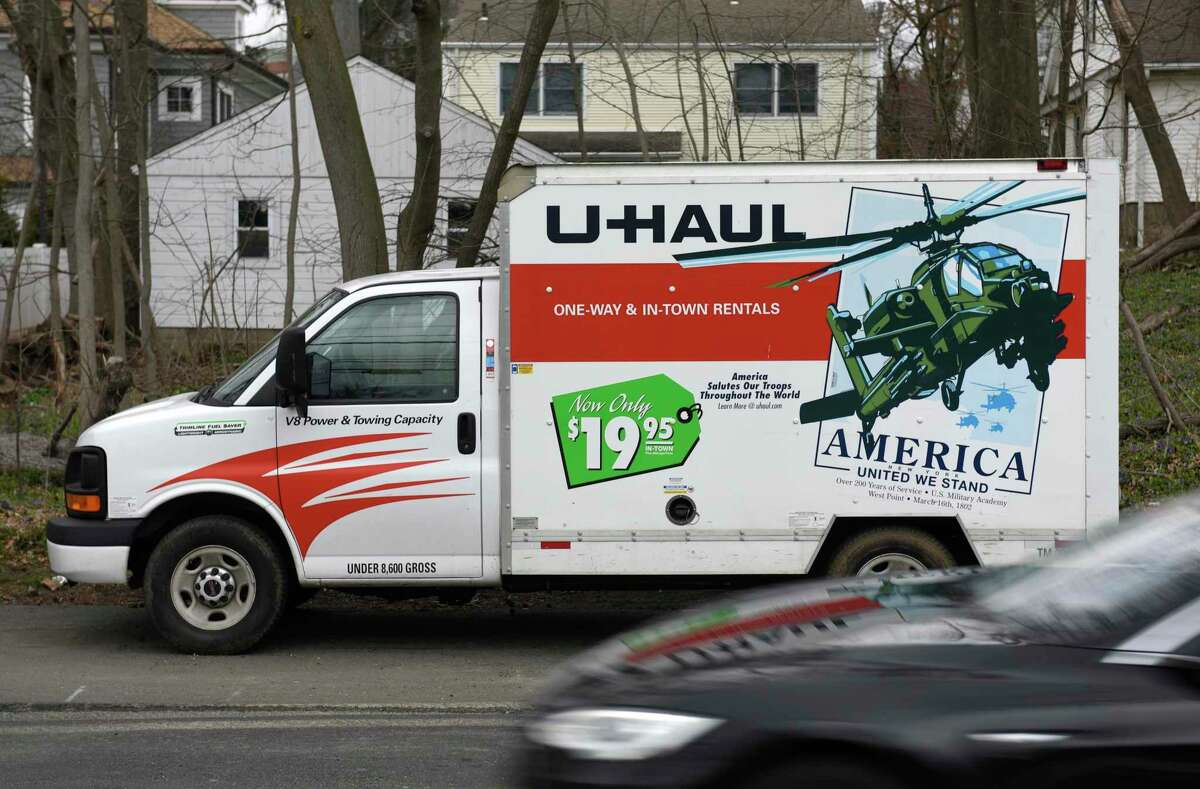 A rental truck is parked by the U-Haul Neighborhood Dealer at Greenwich True Value Hardware in Greenwich, Conn. Wednesday, March 25, 2020. With the coronavirus epidemic at hand, many people are leaving the area to stay in remote rental homes or second homes away from populated areas.