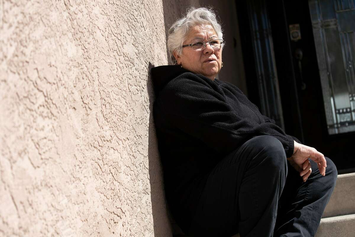 A portrait of Maria Trujillo outside her home on Wednesday, March 25, 2020, in Dublin, Calif. Trujillo works as a janitor. Her coworkers are getting laid off and she fears that she�s going to be laid off too.