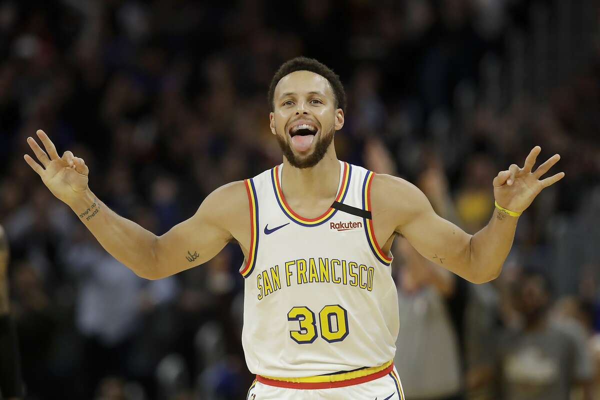 Golden State Warriors guard Stephen Curry celebrates after scoring against the Toronto Raptors during an NBA basketball game in San Francisco, Thursday, March 5, 2020.