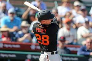 San Francisco Giants catcher Buster Posey swings during their game with the Cleveland Indians at Scottsdale Stadium Thursday, March 5, 2020, in Scottsdale, Arizona.