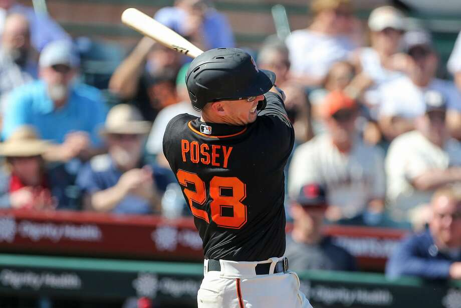 San Francisco Giants catcher Buster Posey swings during their game with the Cleveland Indians at Scottsdale Stadium Thursday, March 5, 2020, in Scottsdale, Arizona. Photo: Darryl Webb / Darryl Webb