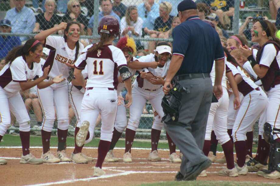 A tremendous welcoming party gets ready to greet Erin Edmoundson at home plate after she slugged a two-run homer in the first inning Thursday night. Photo: Robert Avery, HCN Staff / Robert Avery / Houston Community Newspapers
