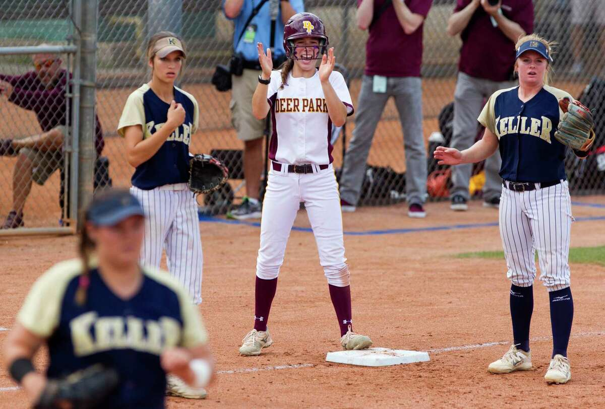 Erin Edmoundson #11 of Deer Park cheers after Alyssa Hernandez beats the throw to first during the first inning of a Class 6A state semifinal game at the UIL State Softball Championships at Red and Charline McCombs Field, Friday, June 2, 2017, in Austin.