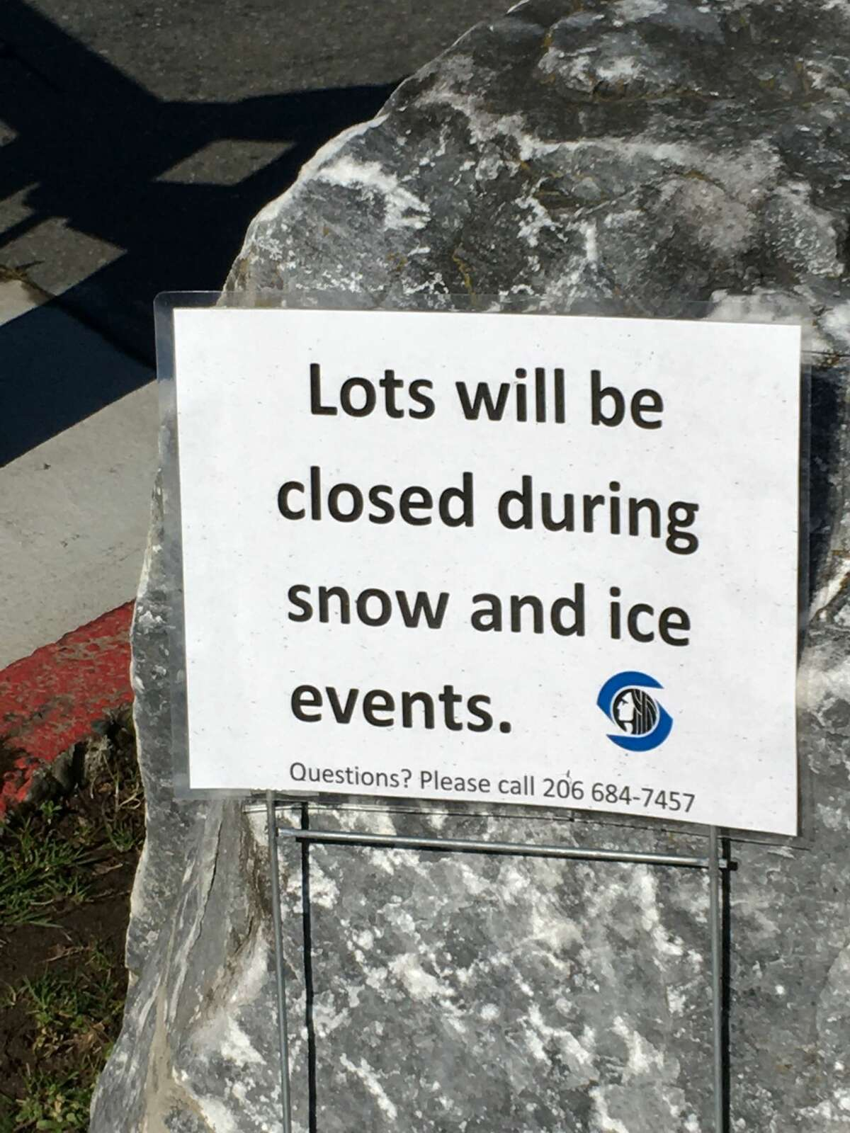 A sign posted at the parking lot entrance of Lincoln Park in West Seattle, Wash. on March 25, 2020. The parking lot was closed in an effort to increase social distancing and prevent gatherings in the parking lot under Gov. Inslee's statewide