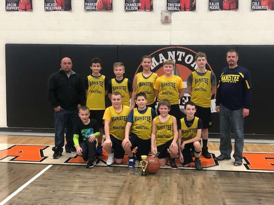 The Manistee sixth grade boys basketball team went 17-0 and won two tournaments over the course of an undefeated season. Photo: Courtesy Photo