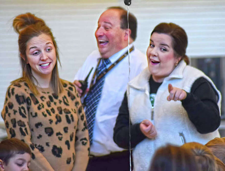 In this February file photo, Goshen Elementary School's principal Curt Schumacher, center, laughs as first-grade teachers Ali Hiller, left, and Brandy Marsh crack jokes with the young authors Wednesday morning. Photo: Tyler Pletsch | The Intelligencer