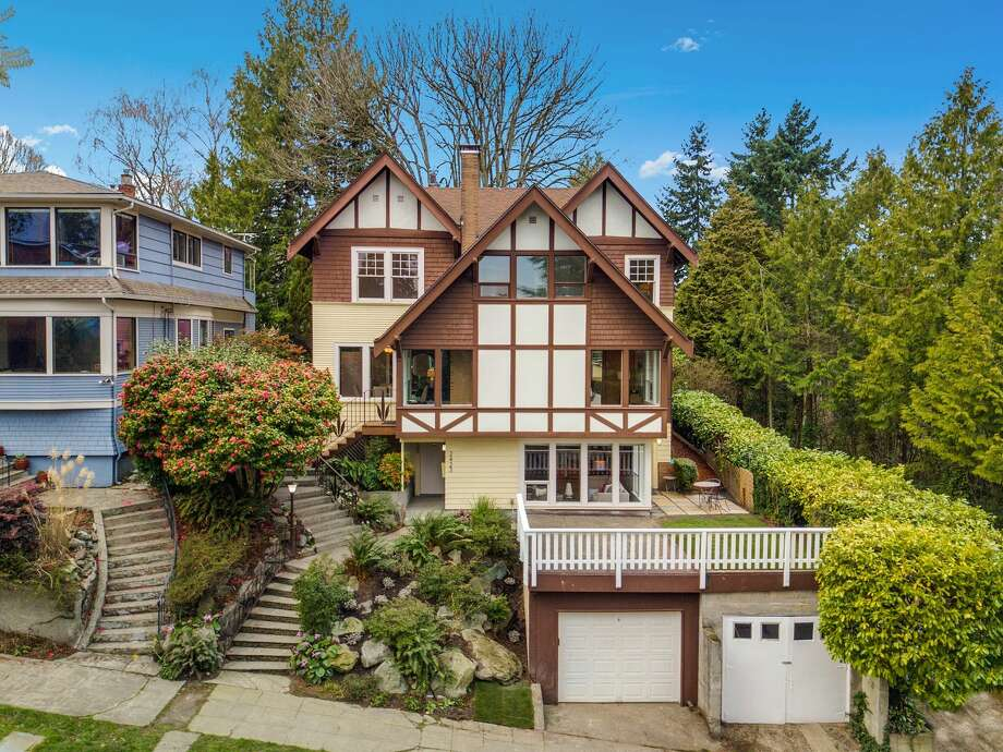 Both in the past and present, this historic home perched on North Capitol Hill has unique charm. Own it for $1.6M Photo: Listing Photos: Joel Highet; Historic Photos Via Brad Davis