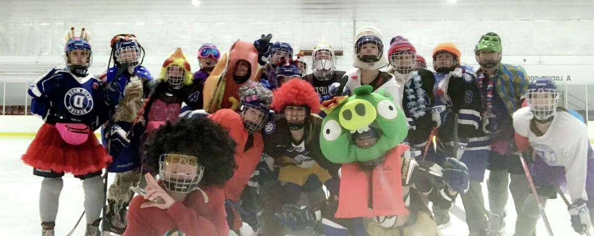 Players on the Darien girls ice hockey team enjoy their final practice together at the Darien Ice House on Wednesday, March 11, 2020.
