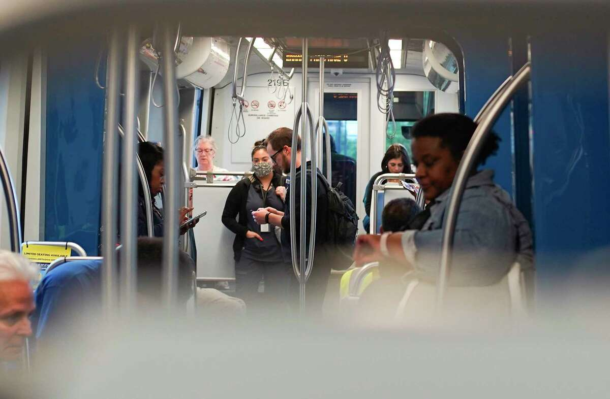 Riders take different methods for social distancing on the Metro in Houston on Tuesday, March 24, 2020.