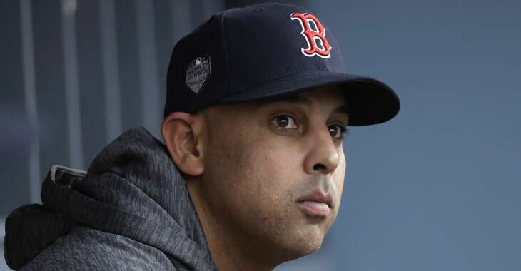 In this Oct. 28, 2018, file photo, Boston Red Sox manager Alex Cora waits for the start of Game 5 of the baseball World Series between the Red Sox and Los Angeles Dodgers in Los Angeles. Cora was fired by the Red Sox on Tuesday, Jan. 14, 2020, a day after baseball Commissioner Rob Manfred implicated him in the sport's sign-stealing scandal. (AP Photo/David J. Phillip, File)