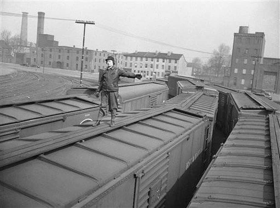 Riding atop the freight car is Mrs. Georgianna M. Wells, whos doing a man-size job as brakeman in the yard of the Pennsylvania Railroad yard in Philadelphia on March 26, 1943. Shes one of 14,645 women, included 2,219 African Americans, employed by the road who are playing an important part in helping keep its vast fleet of locomotives and freight cars rolling. (AP Photo)