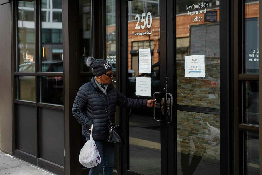 Visitors are unable to gain access to the Department of Labor due to closures over coronavirus concerns, Wednesday, March 18, 2020, in New York. Applications for jobless benefits are surging in some states as coronavirus concerns shake the U.S. economy. The sharp increase comes as governments have ordered millions of workers, students and shoppers to stay home as a precaution against spreading the virus that causes the COVID-19 disease. Photo: John Minchillo, AP / Copyright 2020 The Associated Press. All rights reserved.