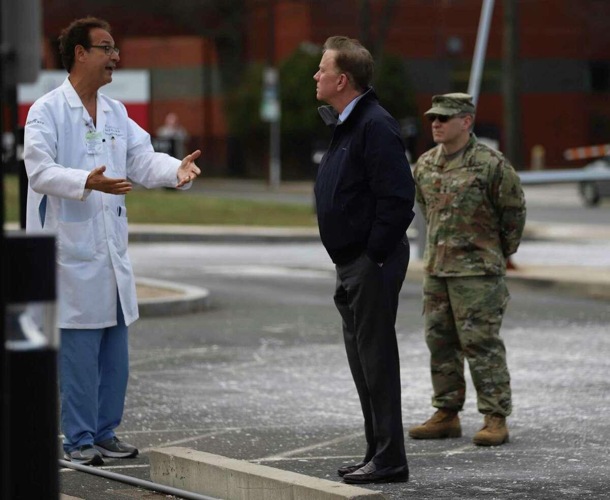 Saint Francis Hospital and Medical Center President John Rodis, left, speaks with Connecticut Gov. Ned Lamont outside Saint Francis Hospital.