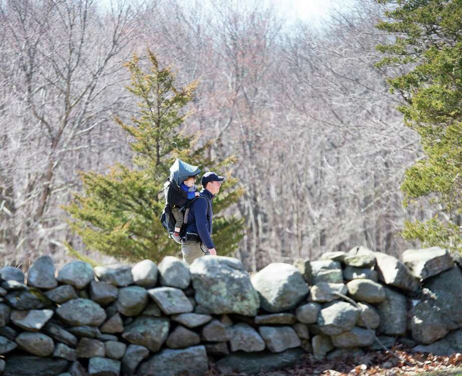 It's a good idea to get outside if you are staying home every day, but try to find a somewhere that is not crowded with other walkers or runners. Photo: Bryan Haeffele /Hearst Connecticut Media