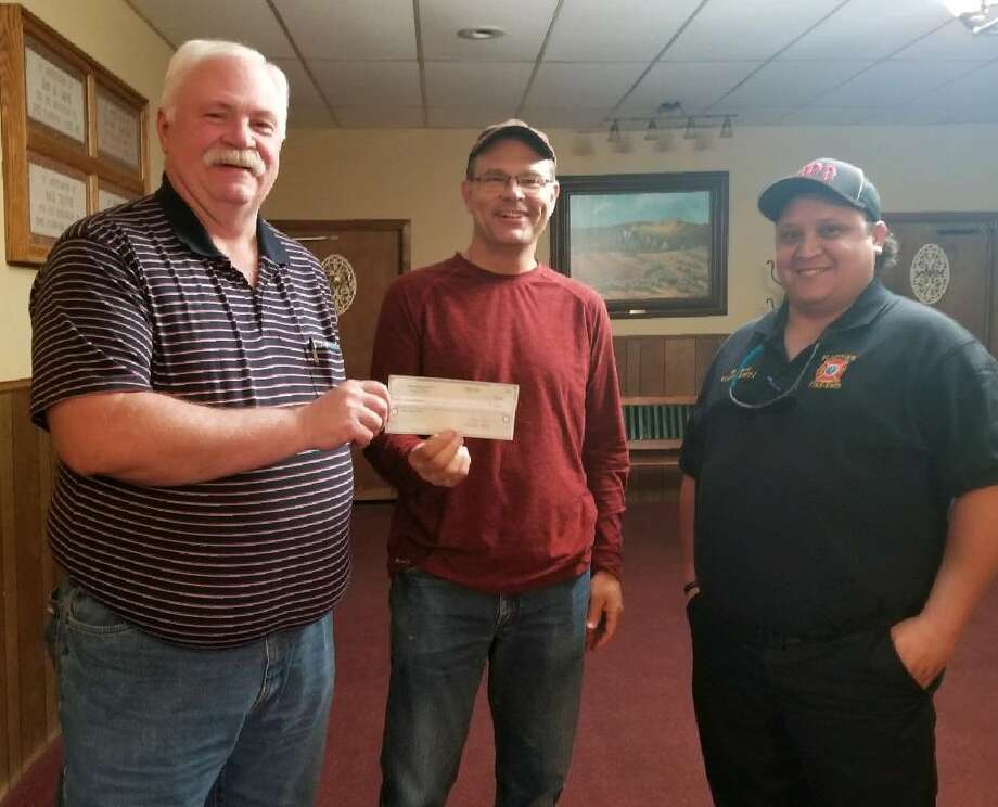 The Plainview Elks Lodge donated a check for $1,000 to the Plainview Faith in Sharing House (FISH) to help assist with current efforts. Presenting the check to FISH board member Kevin Lewis, middle, are Exalted Ruler Mark Nelms (left) and Leading Knight Harrison Hart. Photo: Courtesy Photo/Plainview Elks Lodge