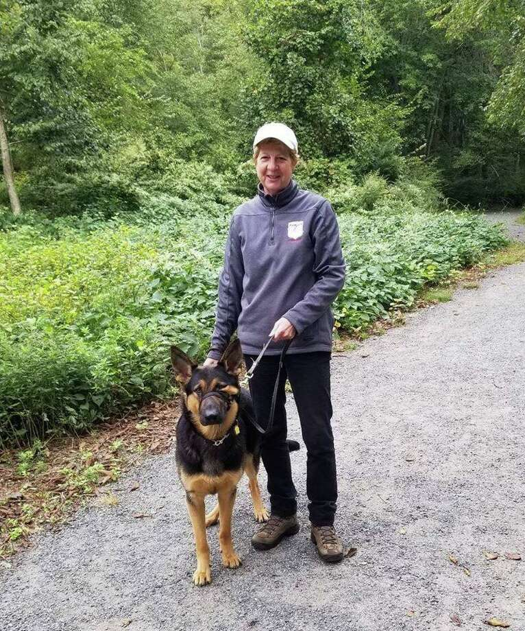 The Norwalk River Valley Trail is a work in progress, but people have been enjoying this Wilton section for several years. Diane Fogerty, a volunteer puppy raiser for Fidelco Guide Dog Foundation, is seen on the trail with Yoda in 2018. Photo: NRVT / Charlie Taney / Contributed Photo