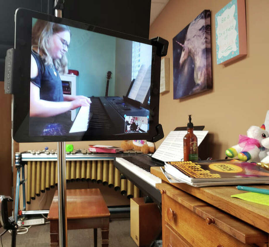 Addison takes piano lessons on Zoom with Tara Wright from Swing City Music. Swing City has moved all of its music lessons online during the COVID-19 pandemic. Photo: For The Intelligencer