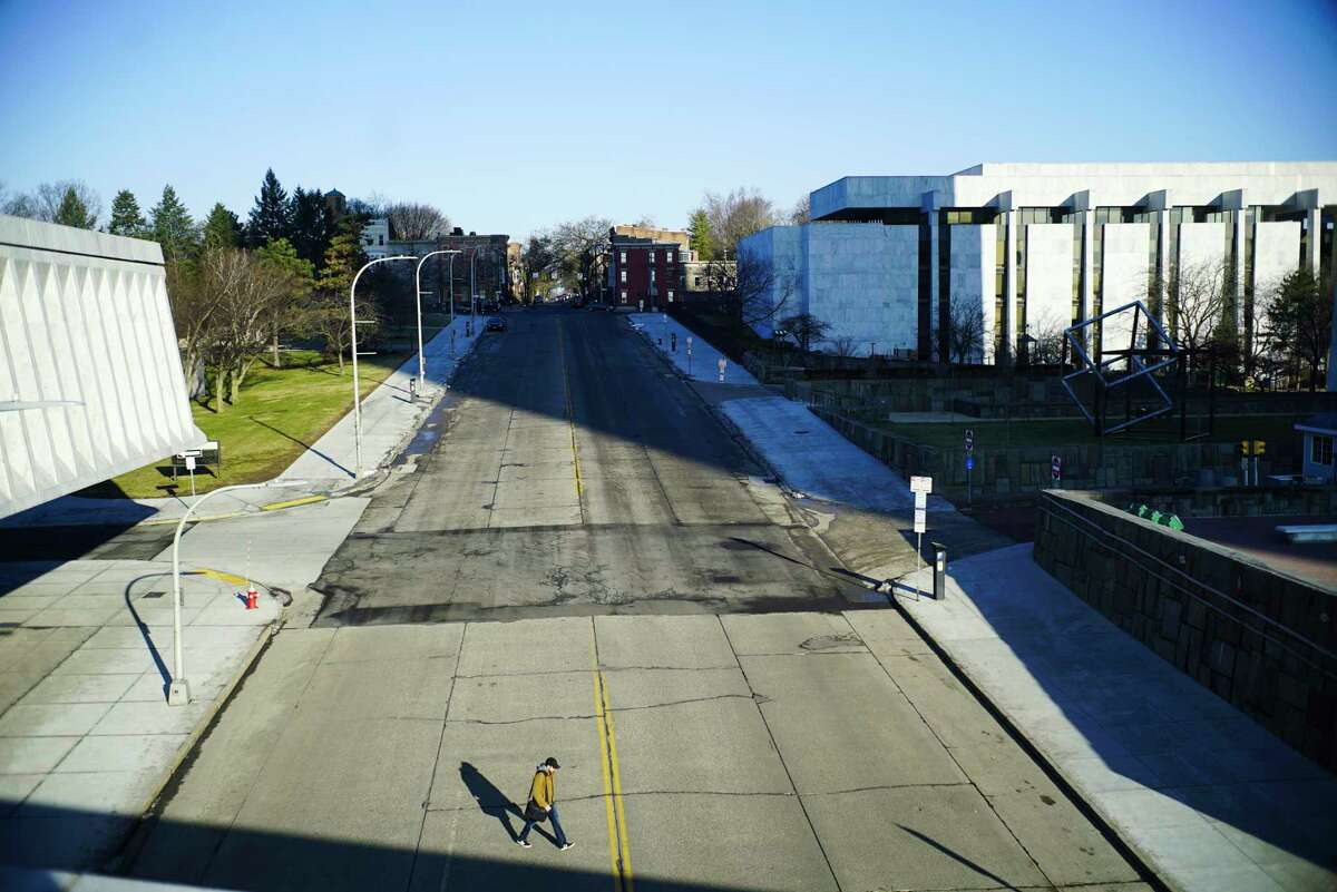 A man crosses an empty Madison Ave. on Thursday morning, March 26, 2020, in Albany, N.Y. (Paul Buckowski/Times Union)