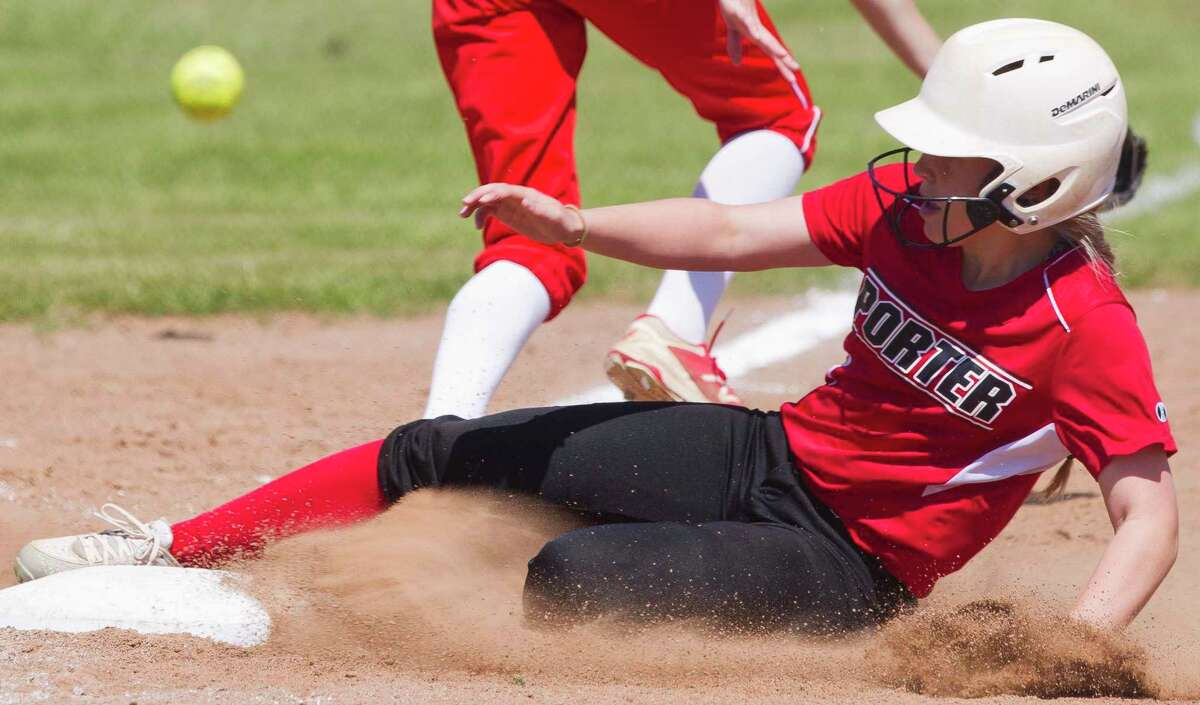 Stella Shaw #3 of Porter slides into third base as Splendora left fielder Mackenzie Lakes drops the throw allowing Shaw to score on the error during the fourth inning of a District 21-5A high school softball game at Splendora High School, Wednesday, March 14, 2018, in Splendora.