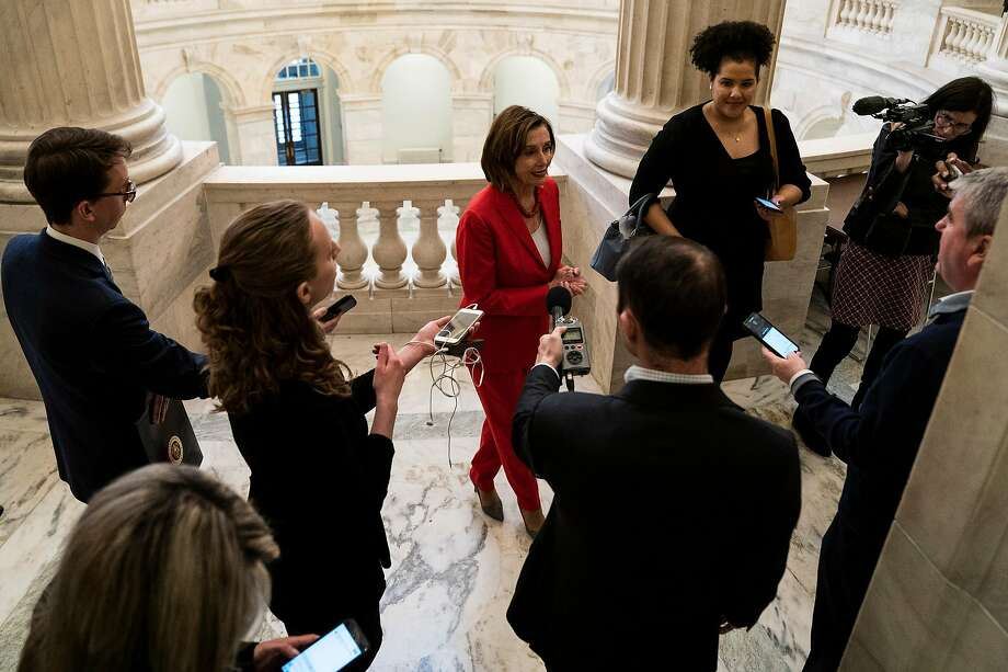 "House Speaker Nancy Pelosi (D-Calif.), shown speaking to reporters Wednesday in Washington, says of the $2 trilliong stimulus package: ""It will pass. It will pass with strong bipartisan support."" Photo: Anna Moneymaker / New York Times"