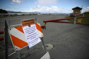 A closed sign is posted in front of a parking lot at China Camp State Park on March 25, 2020 in San Rafael, California. After people who were under order to shelter in place due to COVID-19 packed parks and beaches over the weekend, California Gov. Gavin Newsom ordered all parking lots at State parks and beaches to be closed in an effort to discourage people from visiting.