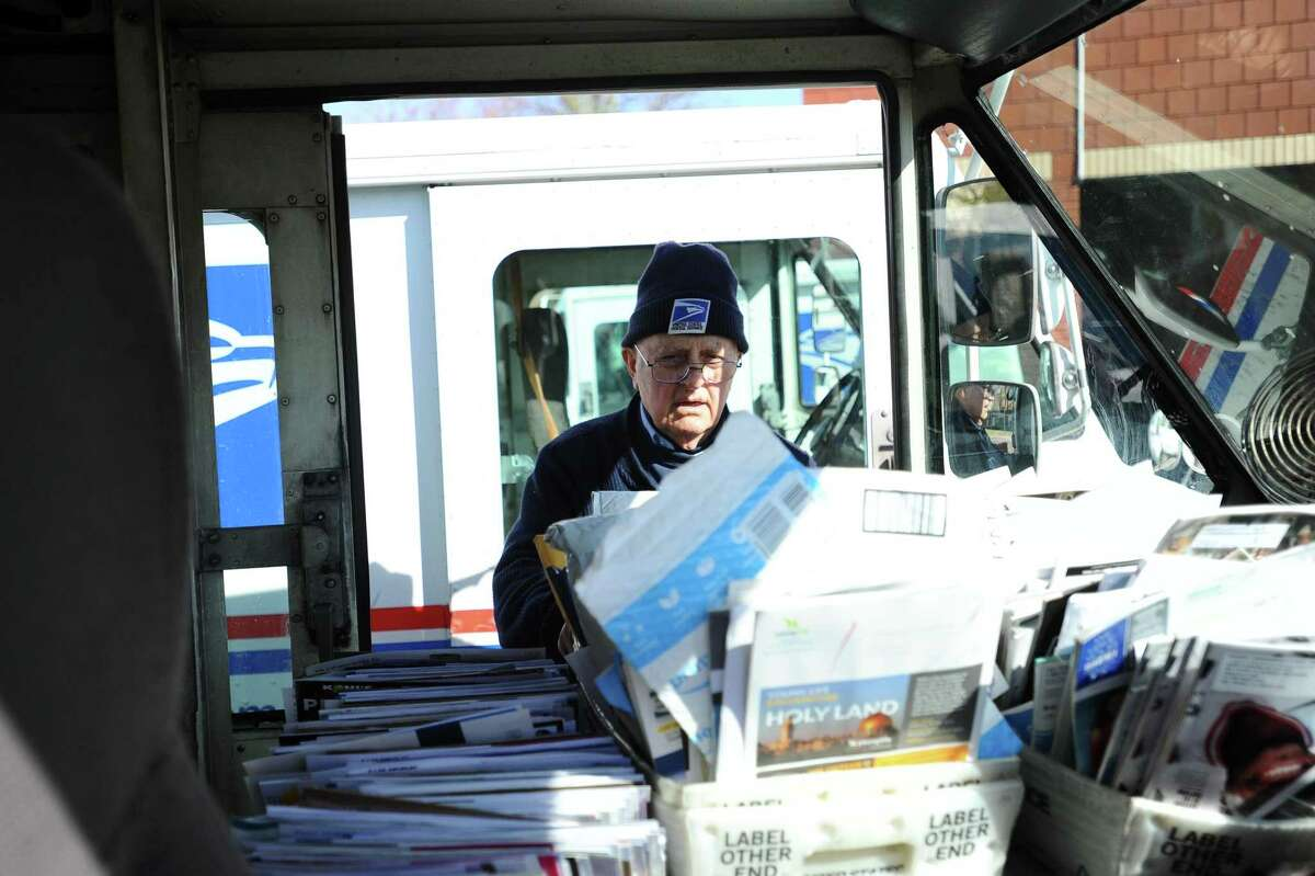 Tony Spadaccini, 81, puts the last bin of mail into his truck outside the Stamford Post Office in 2018.