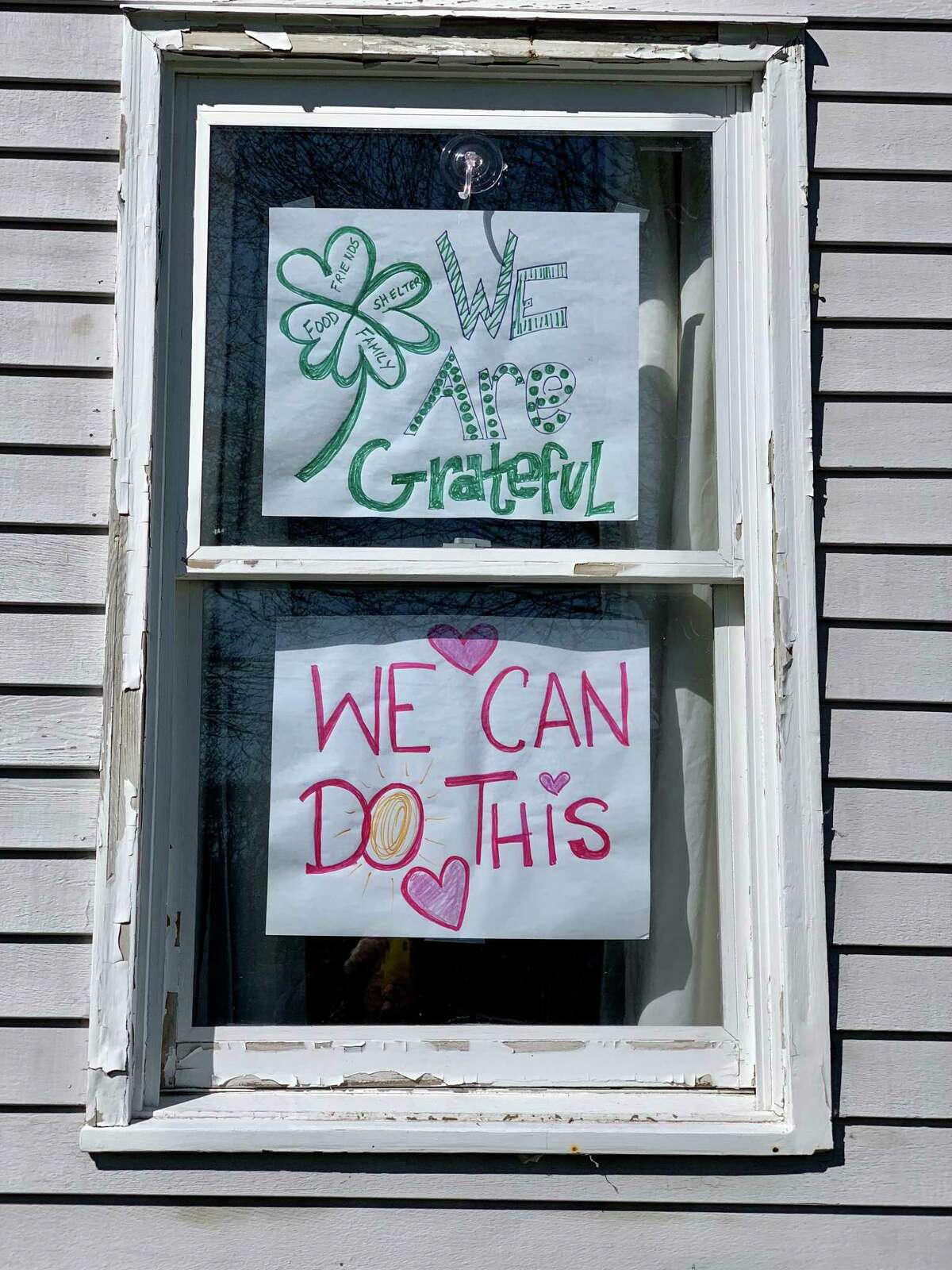 Nicole Lyons and her children - Liam, 12 and Brinley. 9, have shared encouraging messages in the windows of their Darien home.