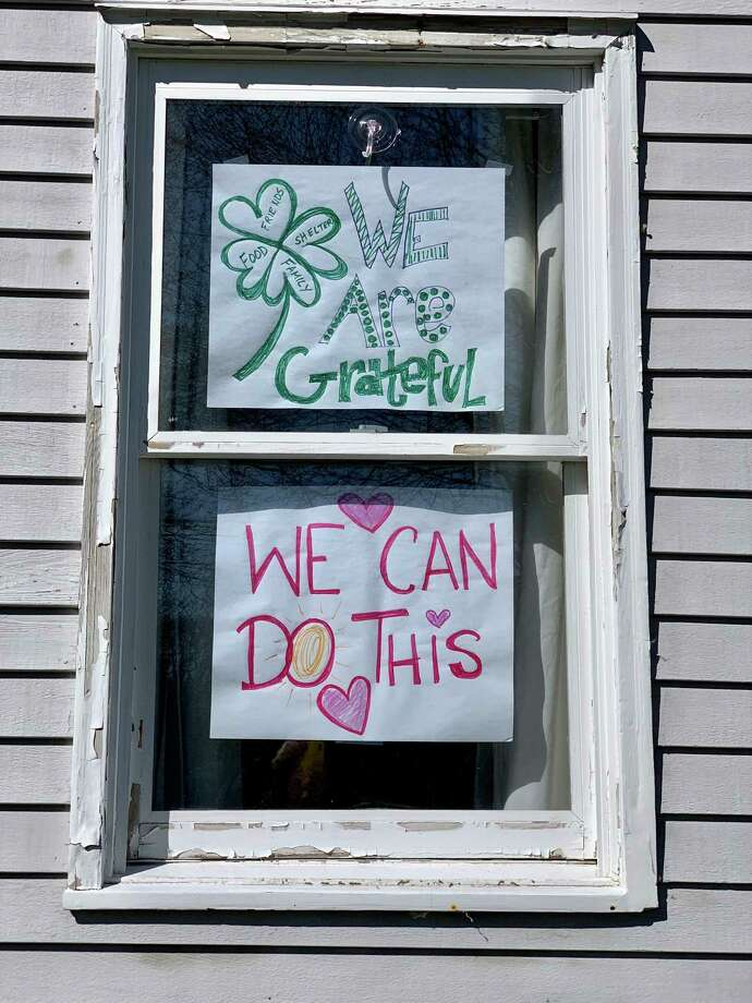 Nicole Lyons and her children — Liam, 12 and Brinley. 9, have shared encouraging messages in the windows of their Darien home. Photo: Willow Buscemi / Contributed Photo