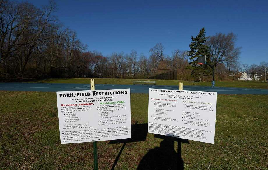 Signage posted inform residents of new restrictions regarding use of basketball courts at Cove Island Park in Stamford, Connecticut on March 24, 2020. Photo: Matthew Brown / Hearst Connecticut Media / Stamford Advocate