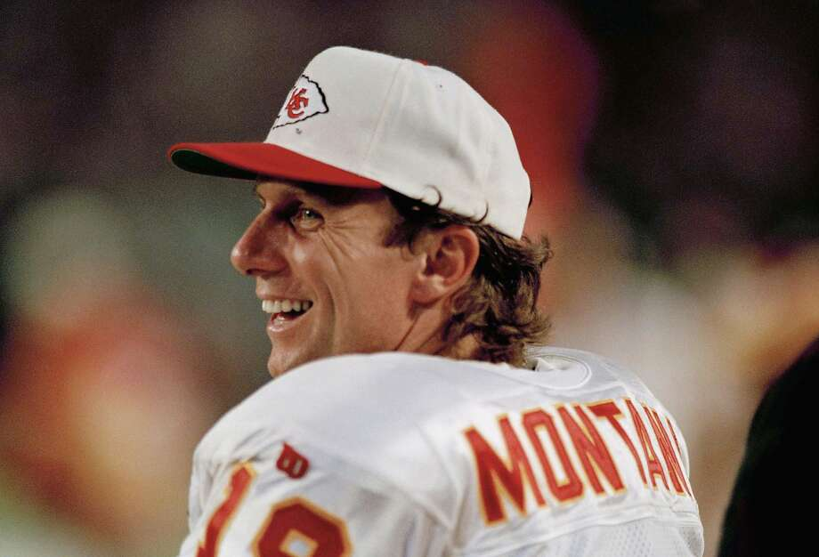 FILE - In this Dec. 12, 1994 file photo Kansas City Chief's quarterback Joe Montana watches from the sidelines during an NFL football game against the Miami Dolphins. Tom Brady's departure from the New England Patriots on Tuesday, March 17, 2020 brings an end to one of the NFL's most memorable eras. Joe Montana was in some ways a previous generation's version of Brady — an iconic quarterback who was calm under pressure and always seemed to have his team in contention for a championship. He won four Super Bowl titles with San Francisco, but after elbow problems limited him for a couple seasons, the 49ers traded Montana to Kansas City. The Chiefs had Montana for two seasons and reached the AFC title game with him once. (AP Photo/Han Deryk, file) Photo: Han Deryk / Associated Press