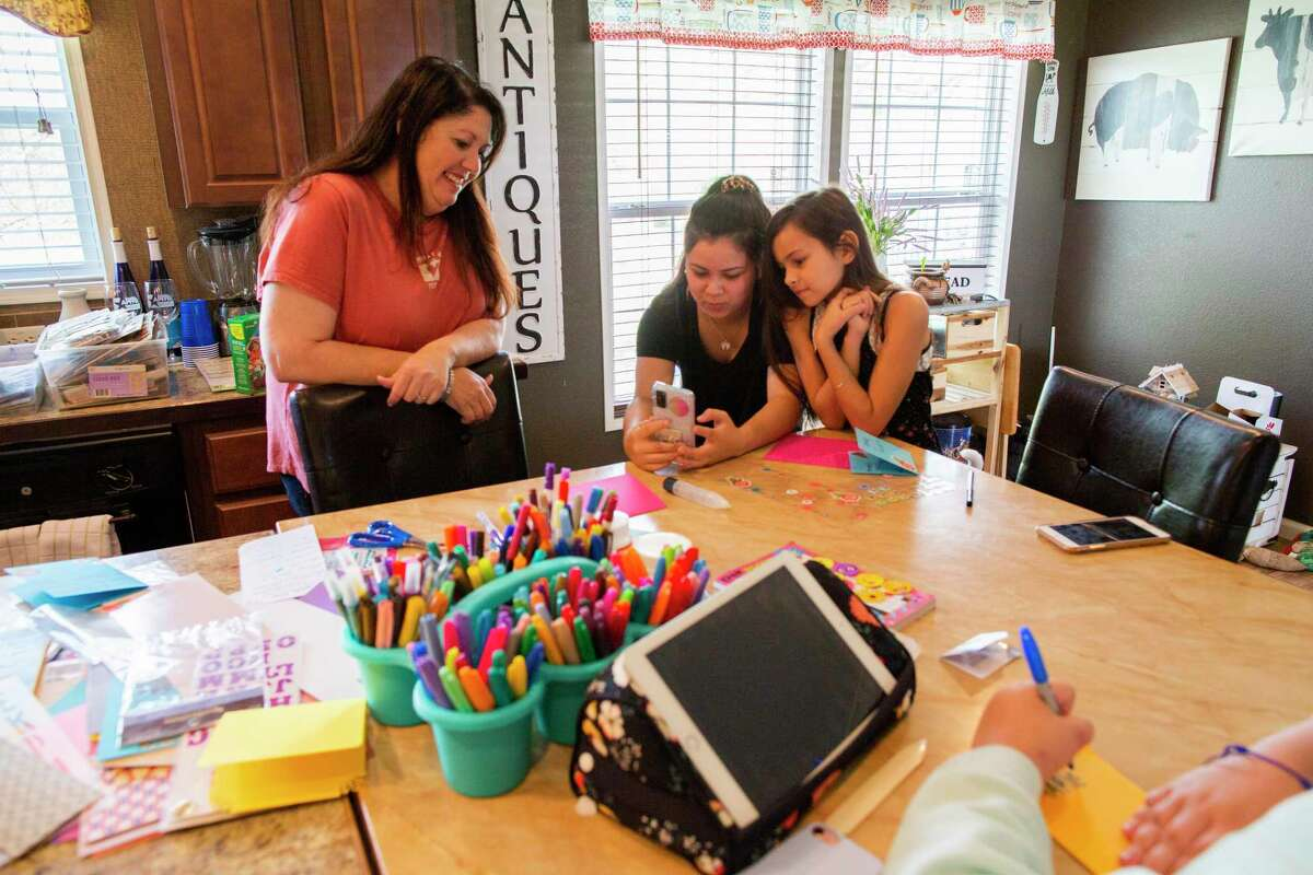Sara Wesley, 19, and Abby Wesley, 9, talk over video chat with their grandfather Larry Wesley.