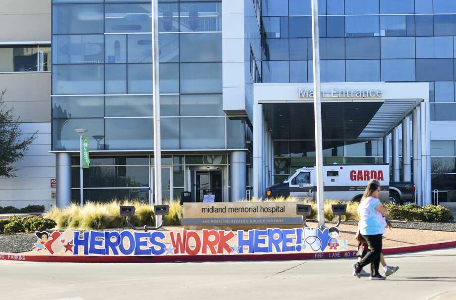 A 'Heroes Work Here!' sign is displayed at the front of the hospital enterance Thursday, March 26, 2020 at Midland Memorial Hospital. Photo: Jacy Lewis/Reporter-Telegram