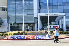 A 'Heroes Work Here!' sign is displayed at the front of the hospital enterance Thursday, March 26, 2020 at Midland Memorial Hospital.