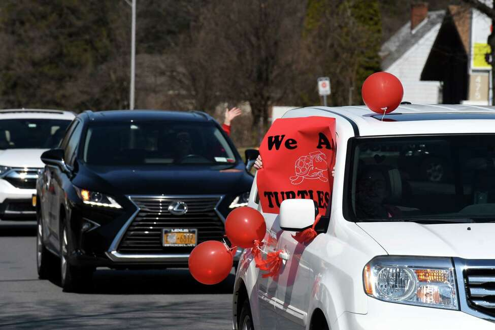 Messages of love for the Shaker Road Elementary staff are displayed during a parade in support of staff, students and family on Thursday, March 26, 2020, on Albany Shaker Road in Colonie, N.Y. (Will Waldron/Times Union)