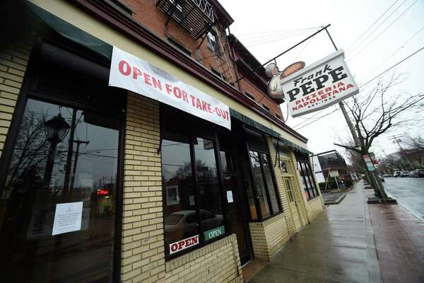 Frank Pepe Pizzeria Napoletana on Wooster Street in New Haven remains open for take-out orders on March 23, 2020.