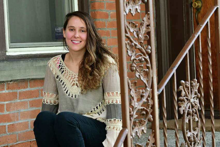 Abby Jones sits on the outside stairs of her home on Thursday, March 26, 2020 in Schenectady, N.Y. Jones recently made it back home from Peru narrowly missing border closures. (Lori Van Buren/Times Union)