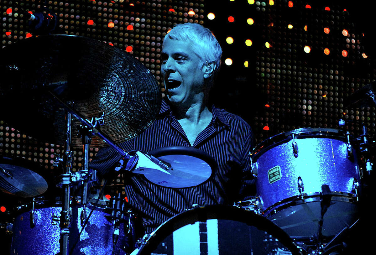 MANCHESTER, UNITED KINGDOM - AUGUST 24: Bill Rieflin of REM performs at Old Trafford on August 24, 2008 in Manchester, England. (Photo by Shirlaine Forrest/WireImage)
