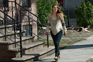 Abby Jones takes a walk in her neighborhood on Thursday, March 26, 2020 in Schenectady, N.Y. Jones recently made it back home from Peru narrowly missing border closures. Although she's glad to be home, she worries about the people who are still stuck in Peru. (Lori Van Buren/Times Union)