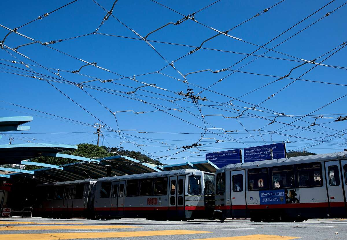 A tangle of cables are seen across the intersection of West Portal Avenue and Ulloa Street as a MUNI train enters the West Portal Station in the West Portal district of San Francisco, Calif. Thursday, September 19, 2019.