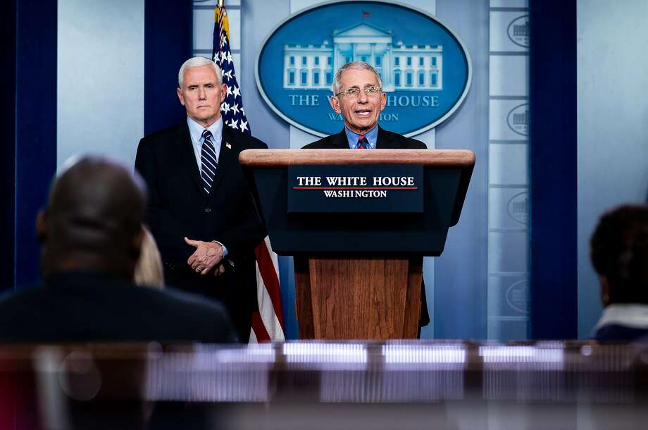 Vice President Mike Pence listens to Dr. Anthony Fauci, director of the National Institute of Allergy and Infectious Diseases, speak during a news conference at the White House in Washington, Wednesday, March, 25, 2020. (Erin Schaff/The New York Times) Photo: ERIN SCHAFF;Erin Schaff / New York Times