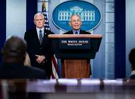Vice President Mike Pence listens to Dr. Anthony Fauci, director of the National Institute of Allergy and Infectious Diseases, speak during a news conference at the White House in Washington, Wednesday, March, 25, 2020. (Erin Schaff/The New York Times)