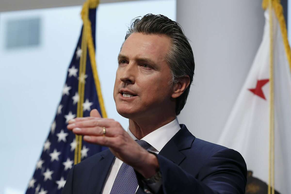 FILE - In this March 23, 2020, file photo California Gov. Gavin Newsom updates the state's response to the coronavirus, at the Governor's Office of Emergency Services in Rancho Cordova, Calif.