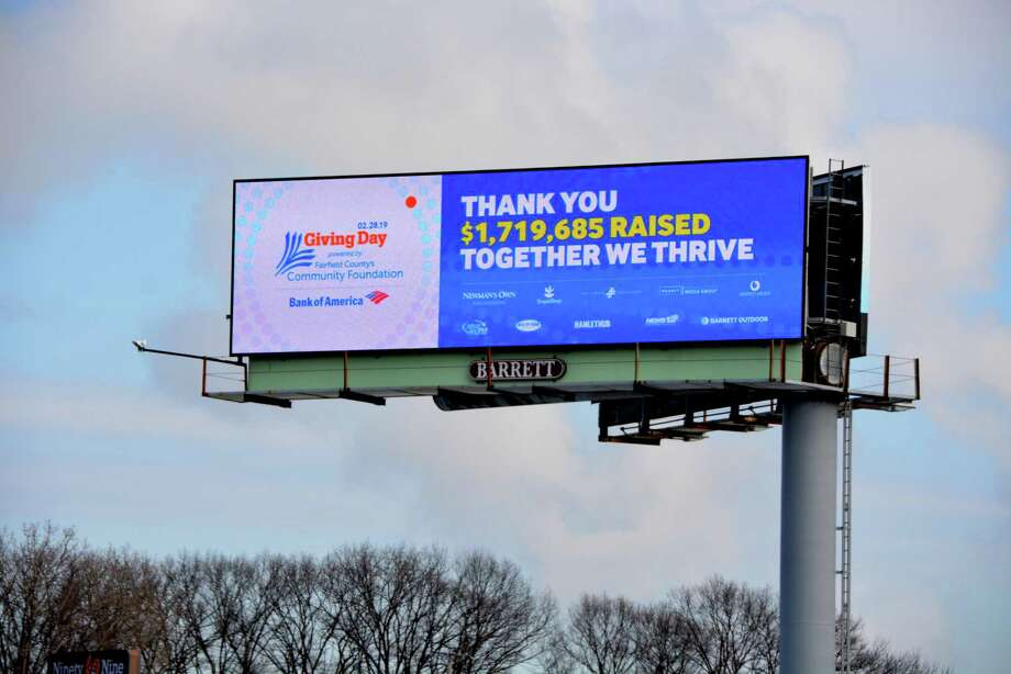 A billboard proclaiming the 2019 fundraising total of Fairfield County's Giving Day. With the U.S. Treasury gearing up to send stimulus checks in April 2020 for households with less than $150,000 in joint income, those feeling relatively financially secure could pay those amounts forward to those in need. Photo: Contributed / Fairfield County Community Foundation / Contributed Photo / Norwalk Hour contributed