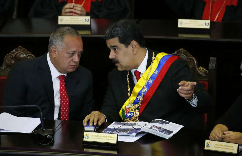 Venezuelan President Nicolás Maduro (right), shown last year with Constitutional Assembly President Diosdado Cabello, condemned the charges. Photo: Ariana Cubillos / Associated Press 2019