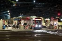 A San Francisco Muni light rail train exits the West Portal Station in San Francisco, Calif. on March 26, 2020.