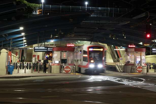 A San Francisco Muni light rail train exits the West Portal Station in San Francisco, Calif. on March 26, 2020.